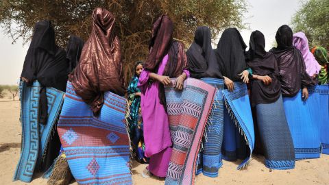 """A traditional ceremony in a village near Abalak, Niger, shows veiled Tuareg women wrapped in rugs to hide their bodies from visitors' looks, according to local custom. Jubber says the Sahel region -- the semiarid belt of land south of the Sahara, to which Abalak belongs -- is the site of what he calls """"the first climate change war,"""" where disputes over resources and land rights have made life difficult for nomadic herdsmen."""