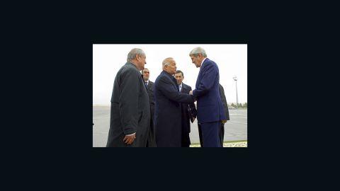 U.S. Secretary of State John Kerry is greeted by Uzbekistan President Islam Karimov on November 1, 2015