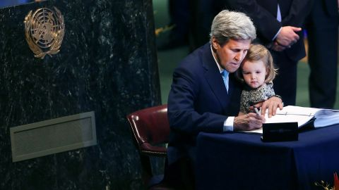 Kerry holds granddaughter Isabel Dobbs-Higginson, 2, as he signs the Paris Agreement to limit global warming in April 2016 at the United Nations.