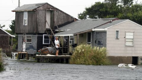 A unidentified man watches the rising water from his home in Hatteras, North Carolina, after Tropical Storm Hermine passed the Outer Banks.