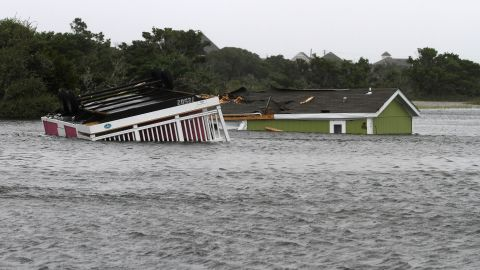 Two structures sit flooded in the creek behind the Hatteras Sands Campground in Hatteras, North Carolina.