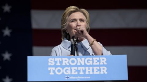 Democratic presidential nominee Hillary Clinton coughs during a Labor Day rally in Cleveland.