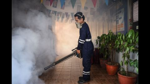 A pest control worker fumigates a school corridor on the eve of the annual national Primary School Evaluation Test in Kuala Lumpur on September 4, 2016. Malaysia reported its first locally transmitted Zika case on September 3, a 61-year-old man who has died of heart-related complications, the government said. / AFP / MOHD RASFAN        (Photo credit should read MOHD RASFAN/AFP/Getty Images)