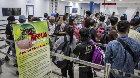 """A banner about Zika virus is seen as ferry passengers <a href=""""http://www.cnn.com/2016/09/05/health/zika-asia-threat/"""" target=""""_blank"""">arriving from Singapore</a> get in line at the immigration check on September 4, in Batam, Indonesia."""