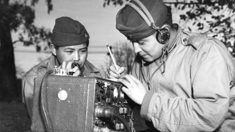 Private First Class Preston Toledo and Private First Class Frank Toledo, cousins and full-blood Navajo Indians, attached to a Marine Artillery Regiment in the South Pacific, relay orders over a field radio in their native tongue, Ballarat, July 7, 1943. (Photo by PhotoQuest/Getty Images)