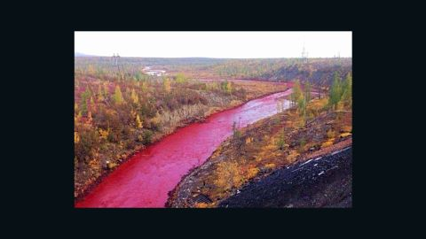 Authorities in Russia are trying to determine why the waters of the Daldykan River in Siberia have suddenly turned bright red.