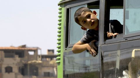 Syrian civilians from the town of Daraya are evacuated by bus from the rebel-held town of Moadamiyet al-Sham on September 2, 2016 to be taken to a shelter in the government-controlled town of Hrajela.    More than 300 Syrians living in the opposition-held Moadimayet al-Sham district after fleeing fighting in rebel-held Daraya were evacuated under a deal, Syrian state media reported. The civilians evacuated were mostly women and children, and have been in Moadimayet al-Sham for around three years, after fleeing clashes in Daraya.  / AFP PHOTO / LOUAI BESHARALOUAI BESHARA/AFP/Getty Images