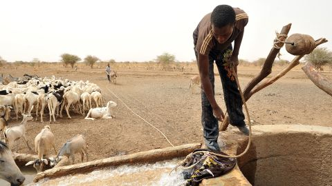 """A Bedouin takes water from a well near Nema, southeastern Mauritania, 2012. The West African nation has retained one cultural trait that was dominant during the time of Mansa Musa I: slavery (<a href=""""http://edition.cnn.com/interactive/2012/03/world/mauritania.slaverys.last.stronghold/"""">which is illegal, but widespread)</a>. Jubber writes of his hopes that """"the future will be very different,"""" and the region will regain its great wealth from sources such as solar energy instead."""