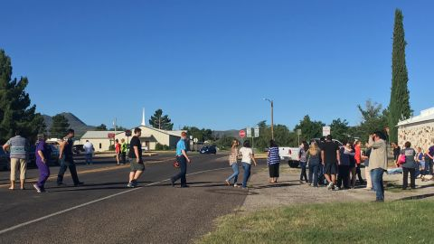 People cross a street in western Texas as Alpine High School is evacuated following a shooting there Thursday, September 8. One person shot and wounded another before the shooter died of a self-inflicted gunshot, Brewster County Sheriff Ronny Dodson said. (Courtesy Alpine Avalanche)