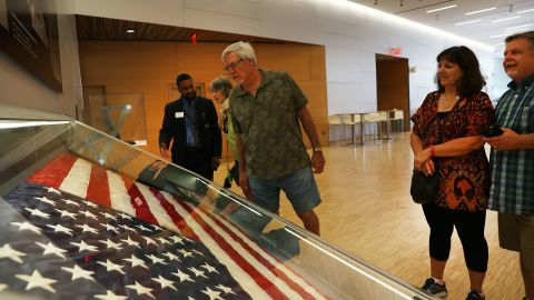 """NEW YORK, NY - SEPTEMBER 08:  The American flag that was raised by firefighters above the site of the 9/11 attacks on the World Trade Center in New York on 2001 is displayed for the first time at the National September 11 Memorial & Museum after turning up in Washington state two years ago on September 8, 2016 in New York City. The flag was made iconic in a photo of firefighters raising it on the day of the attacks. The flag disappeared from Ground Zero during the site cleanup and was mysteriously turned into a police department by a man who gave his name only as """"Brian"""". Sunday is the 15th anniversary of the terror attacks.  (Photo by Spencer Platt/Getty Images)"""