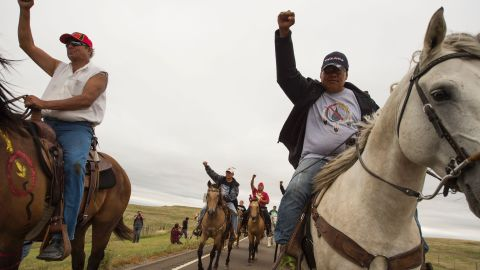 Native Americans ride with raised fists to the sacred burial ground on September 4 to protest the Dakota Access Pipeline.