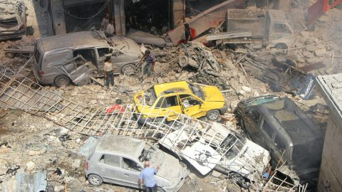 Syrians search for victims at the scene of a reported airstrike in Idlib on September 10.