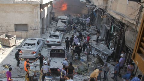 EDITORS NOTE: Graphic content / Syrians search for victims at the scene of a reported air strike on the rebel-held northwestern city of Idlib on September 10, 2016.  More than 290,000 people have been killed in Syria since its conflict erupted in March 2011, and millions displaced by the fighting. / AFP / Omar haj kadour        (Photo credit should read OMAR HAJ KADOUR/AFP/Getty Images)