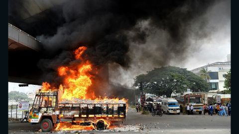 A truck from the state of Tamil Nadu burns Monday, September 12, after pro-Karnataka activists set it afire in Bangalore.