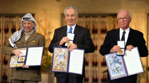 OSLO, NORWAY - DECEMBER 10: (FILE PHOTO) Palestinian leader Yasser Arafat (L), Israeli Foreign Minister Shimon Peres (C) and Israeli Premier Yitzhak Rabin display their Nobel Peace Prizes December 10, 1994 in Oslo, Norway. (Photo by Yaakov Saar/GPO via Getty Images)