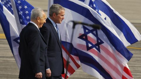 Israeli President Shimon Peres welcomes US President George W.  Bush upon his arrival at Ben-Gurion International Airport near Tel Aviv, Israel, on January 9, 2008.