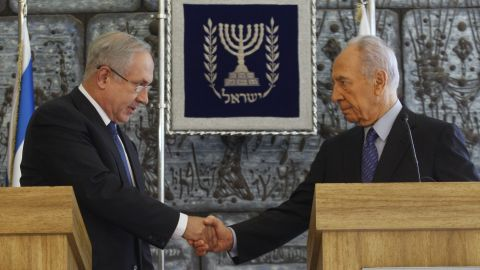 Israeli President Shimon Peres shakes hands with Likud Party leader Benjamin Netanyahu during their press conference in Jerusalem on February 20, 2009.  Peres gave the hawkish Netanyahu, who became Prime Minister the following month, formal permission to put together the country's next government.
