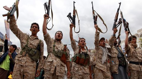 Men loyal to the Huthi movement brandish their weapons in March 2015 during a gathering in Sanaa to show support the Shiite Huthi militia and against the Saudi-led intervention in the country.