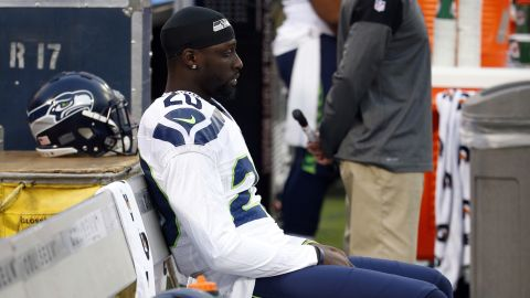 Seattle Seahawks' Jeremy Lane sits as the national anthem plays before a preseason match against the Oakland Raiders on September 1, 2016, in Oakland.