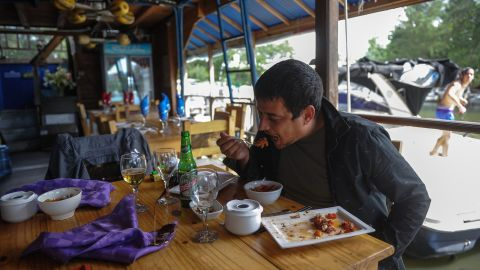 A man eats in a private restaurant in Havana where the lionfish is served.<br /><br />There are increasing efforts to reduce the lionfish population by marketing them as food, with conservation group REEF producing a dedicated cookbook.