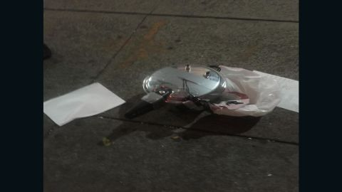 A device at a second location in Chelsea appears to be a pressure cooker with dark colored wiring coming out of the top center of the device. The device, mentioned earlier by police, is connected by silver duct tape to a small dark colored device attached to the outside of the pressure cooker, according to multiple local and federal law enforcement officials.