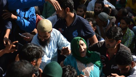 Mourners attend Nasir Shafi's funeral on Saturday.