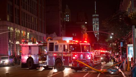 TOPSHOT - A fire truck is seen near a blocked off road near the site of an alleged bomb explosion on West 23rd Street on September 17, 2016, in New York. An explosion in New York's upscale and bustling Chelsea neighborhood injured at least 25 people, none of them in a life-threatening condition, late Saturday, the fire department said. / AFP / Bryan R. Smith        (Photo credit should read BRYAN R. SMITH/AFP/Getty Images)