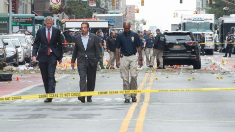 New York Governor Andrew Cuomo(L) and New York City Mayor Bill de Blasio(R) arrive at the scene of an explosion on West 23rd Street September, 18, 2016 in New York.  An  explosion rocked one of the most fashionable neighborhoods of New York on September 17 night, injuring 29 people, one seriously, a week after America's financial capital marked the 15th anniversary of the 9/11 attacks. Mayor Bill de Blasio indicated the blast was not accidental, even if there was no known link to terrorism. The blast occurred in Chelsea -- an area packed with bars, restaurants and luxury apartment blocks -- at a typically bustling time of the weekend.  / AFP / Bryan R. Smith        (Photo credit should read BRYAN R. SMITH/AFP/Getty Images)