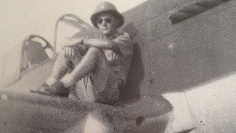 Flying Tiger crew chief Frank Losonsky sits on the wing of a P-40 Warhawk fighter plane in 1942.