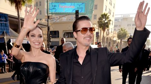 """Actors Angelina Jolie and Brad Pitt attend the World Premiere of Disney's """"Maleficent"""" at the El Capitan Theatre in 2014 in Hollywood, California."""