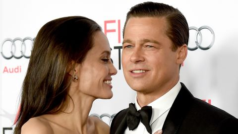 """LOS ANGELES, CA - NOVEMBER 05:  Actress/director Angelina Jolie Pitt (L) and husband actor Brad Pitt arrive at the AFI FEST 2015 presented by Audi opening night gala premiere of Universal Pictures' """"By The Sea"""" at the Chinese Theatre on November 5, 2015 in Los Angeles, California.  (Photo by Kevin Winter/Getty Images)"""