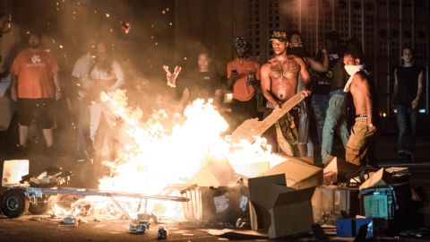 After blocking traffic on I-85, some of the protesters took cargo from tractor-trailers and set it on fire.