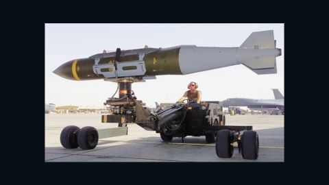A GBU-31(V)3/B 2,000 lb penetrator is loaded into the weapons bay of a USAF B-1B during combat operations over Iraq in 2003.
