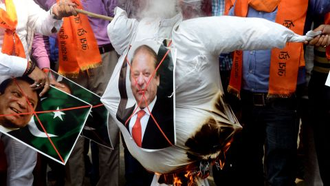 Indian right-wing activists burn an effigy of Pakistan's Prime Minister Nawaz Sharif during a protest against Pakistan, in New Delhi on September 19, 2016. India on September 19 weighed its response to a bloody raid on an army base in Kashmir which  fuelled tensions with nuclear-armed Pakistan, as some politicians called for military action after the worst attack of its kind in over a decade. New Delhi has said that Pakistan-based militants were behind the September 18 attack in which 17 soldiers were killed, raising the prospect of a military escalation in the already tense disputed Himalayan region.  / AFP / MONEY SHARMA        (Photo credit should read MONEY SHARMA/AFP/Getty Images)