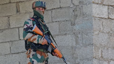 An Indian army soldier takes up a position near the site of a gunbattle between Indian army soldiers and rebels inside an army brigade headquarters near the border with Pakistan, known as the Line of Control (LoC), in Uri on September 18, 2016. Militants armed with guns and grenades killed 17 soldiers in a raid September 18 on an army base in Indian-administered Kashmir, the worst such attack for more than a decade in the disputed Himalayan region. / AFP / TAUSEEF MUSTAFA        (Photo credit should read TAUSEEF MUSTAFA/AFP/Getty Images)