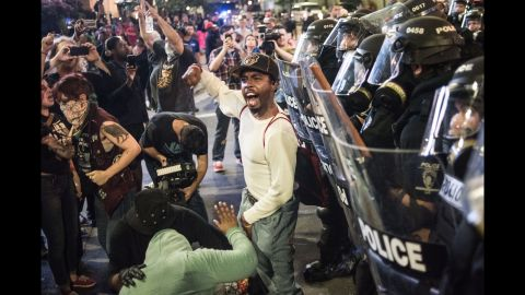 A protester shouts to a crowd in downtown Charlotte on the evening of September 21.