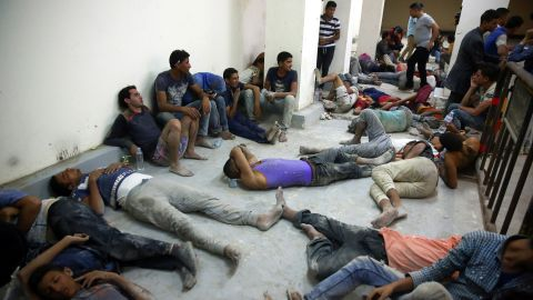 Survivors, rescued by Egyptian Coast Guard members from a boat submerged on its way to Europe at the Mediterranean Sea.