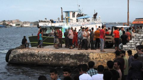 People gather at the port at Rashid.