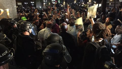 Protesters confront police officers near Trade and Tryon streets on September 22.