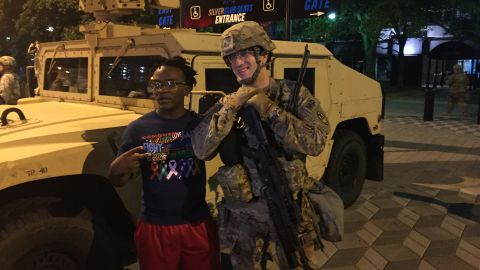 Charlotte protests: Protester poses with National Guardsman