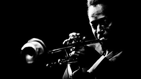 """Miles Davis plays the trumpet at the Monterey Jazz Festival in Monterey, California, in 1964. It's one of the images in a new book, <a href=""""http://www.reelartpress.com/catalog/edition/90/jazz-festival-jim-marshall"""" target=""""_blank"""" target=""""_blank"""">""""Jazz Festival""""</a> by legendary music photographer Jim Marshall."""