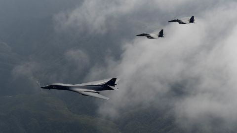 A U.S. Air Force B-1B Lancer is flanked by two F-15K Slam Eagles during a flight over South Korea, September 21, 2016.