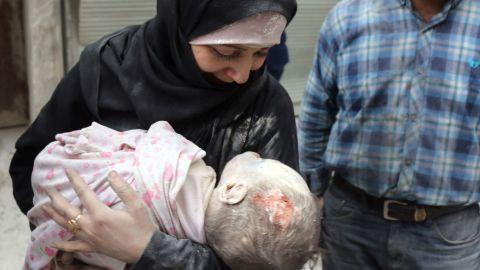 Muhammad Sawas' devastated mother cradles his lifeless body.