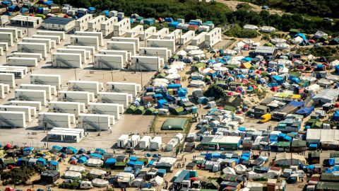 """This aerial view taken Tuesday, August 16, shows the tents and shipping containers housing migrants in """"The Jungle."""""""