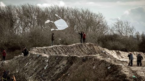 A migrant flies a kite on Friday, February 19.