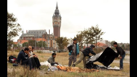 """Displaced from """"The Jungle"""" camp, Afghan migrants congregate in Calais' harbor in September 2009."""