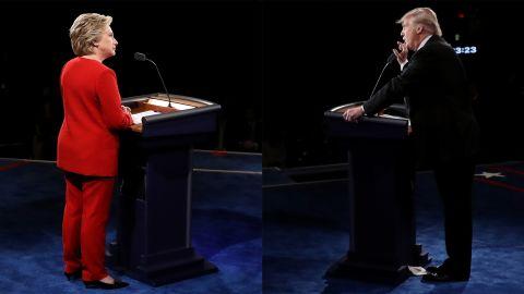 Republican presidential nominee Donald Trump speaks as Democratic presidential nominee Hillary Clinton listen during the Presidential Debate at Hofstra University on Monday, September 26 in Hempstead, New York.