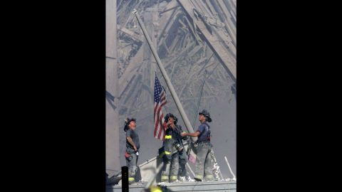 """Firefighters George Johnson, Dan McWilliams and Billy Eisengrein raise a flag at the site of the World Trade Center in New York after the terror attacks on September 11, 2001. The scene was immortalized by photographer Thomas E. Franklin and has been compared to the iconic image of the flag-raising at Iwo Jima. <a href=""""http://www.cnn.com/SPECIALS/us/cnn-films-the-flag/index.html"""">CNN Films' """"The Flag""""</a> examines what happened to the flag at ground zero and explores its impact in the aftermath of the tragedy."""