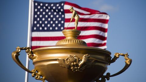 The American flag flies behind a statue of the Ryder Cup trophy at Hazeltine National Golf Course in Chaska, Minnesota, September 26, 2016, ahead of the 41st Ryder Cup. / AFP / JIM WATSON        (Photo credit should read JIM WATSON/AFP/Getty Images)