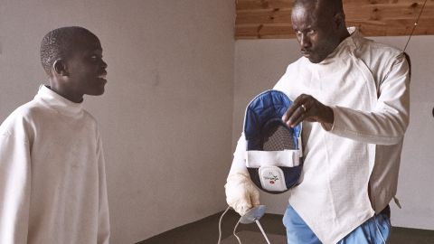 Trainor  Abdouaye Gueye prepares to begin a training session with Mansour.